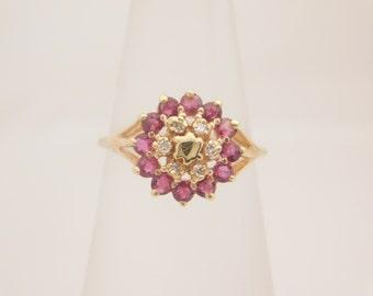 Ladies Round Cut Ruby & Diamond Cluster Ring 10K