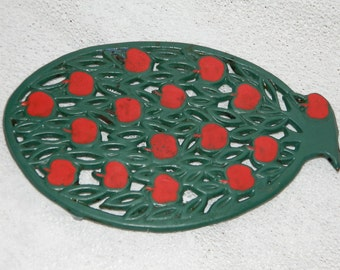 BELOW of dish cast-iron... France. Table mat iron, french vintage