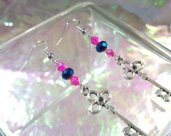 KEY former in dangling earrings with blue and pink ball