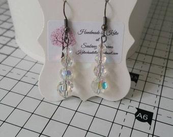 Swarovski drop earrings.