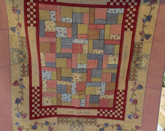 Pastel coloured family Heirloom quilt