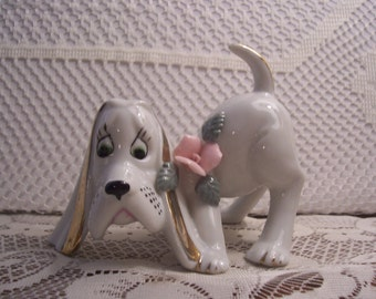Whimsical Basset Dog Figurine with Pink Flower