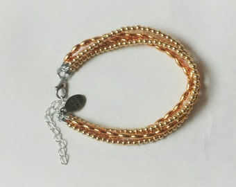 Multi strand gold bead bracelet adjustable fit with extender chain
