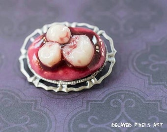 Bloody tooth broach