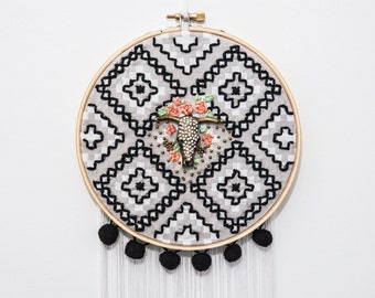 Roses and skull embroider and beaded on an embroidery hoop as a wall decoration