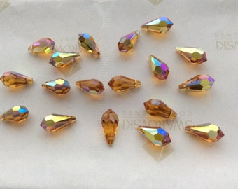 24 pieces Swarovski #6000 11x5.5mm Crystal Topaz AB Teardrop Faceted Pendant Beads