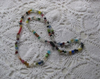 S- Glass Mardi Gras beads from New Orleans Carnival Parade