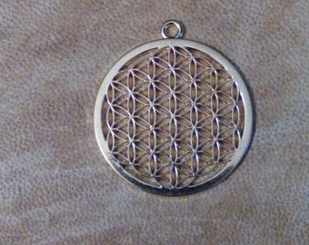 Gold toned sacred geometry flower of life pendant.bjewelry supplies. Flower of life.