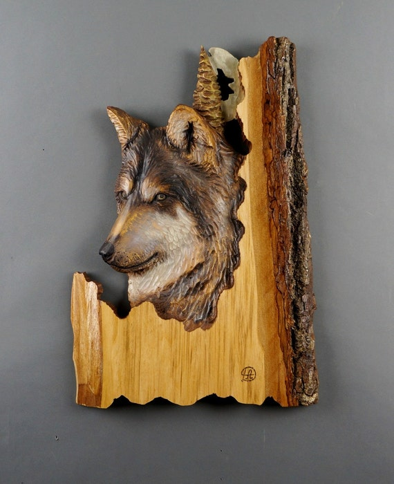 Wolf carved on wood carving linden tree with bark hand