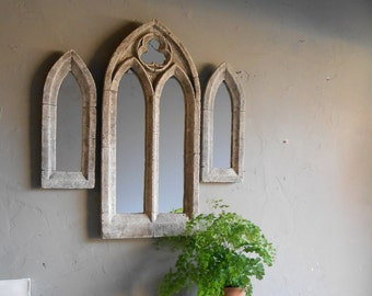 A trio of gothic mirrors,antique church window arrangement for the wall.