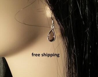 Smoky quartz earrings set in sterling silver, tear drop shape, faceted