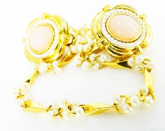 Shop Pick! Mad Men vibe baby peach pink cabochon surrounded by tiny pearls sweater clip or sweater guard. Brilliant gold. Free trinket box