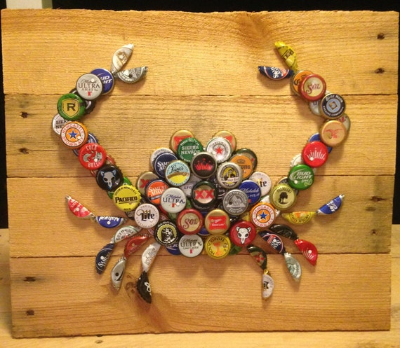 crab wall art with mixed bottle caps on pallet by
