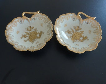 A pair of Limoges cream and gold leaf dishes. Gold Limoges dishes.