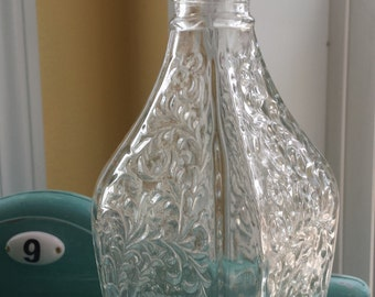 Vintage DuBouchett Liquor Decanter Bottle. Unusual Shape with a Raised Leaf Design. Clear Glass.
