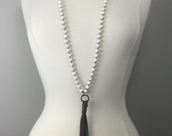 Hand knotted beaded necklace with brown leather tassel