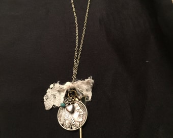 Indian chief coin and arrow necklace