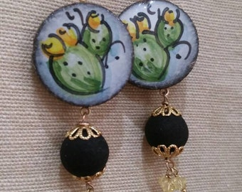 Swarovski and 925 Silver lava stone pendants,