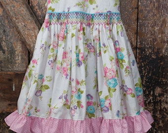 Smocked, ruffled, party dress. Vintage-look floral print, with pink gingham underskirt and multi-colored ruffles. Elastic/tie back. Sz 3-4T
