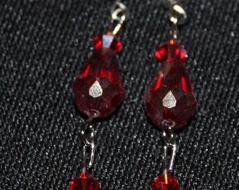 Red crystal dangling earrings