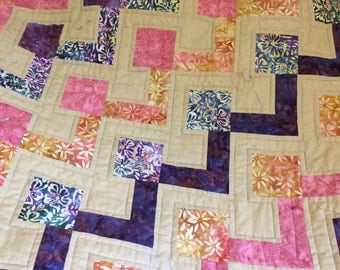 Handmade lap quilt or tablecloth. 100% cotton quilt top with calico back. Machine pieced and quilted.