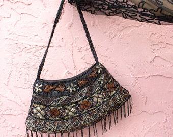 Fully beaded front/back/strap/fringe handbag with sown in leaf design
