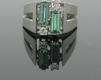 Geometric tourmalines and diamonds ring, 18kt gold