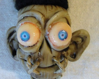 Shrunkin' Head on a string
