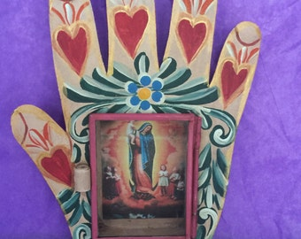 Virgin  Guadalupe behind glass with hand colored hand