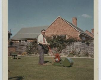 Lawnmower man. British suburbia 1960's vintage vernacular colour square snapshot photograph.