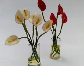 Vase of glass with anthuriums