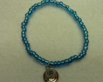 Rubber Bracelet with bright blue beads and smiley
