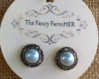 Faux pearl and silver finish button earrings