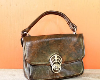 60s 70s brown vinyl purse . brown 1960s kelly bag purse with orb closure . marble brown purse