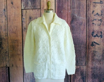 pointelle cardigan by Cuddle Knit . vintage cardigan with pockets, palest yellow cream cardigan . 1960s 70s cardigan sweater, medium