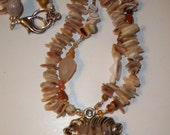 Silver Lion Pendant Necklace with Large Silver Lion Head and Double Strand Shell Necklace
