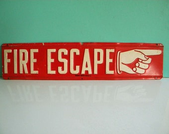 Vintage Fire Escape Sign Industrial Heavily Embossed on Steel with Pointing Hand
