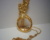 Angel magnifying glass necklace Avon angel necklace Gold tone angel necklace Magnifying glass necklace
