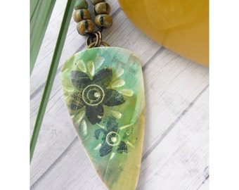 Polymer Clay Pendant Beach Tropical Jewelry featuring Flower Design in Black, Olive Green, Turquoise, Gold and White