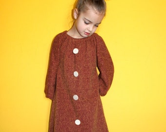 Girls fall dress with hidden pockets in size 6-8.