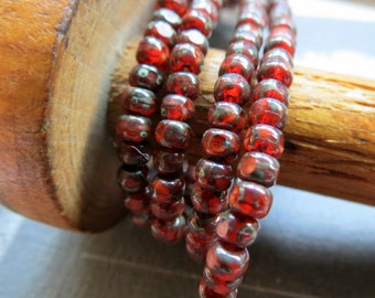 Back in Stock POMEGRANATE .  Czech Tri cut Picasso Seed Beads . size 6/0 . (50 beads)