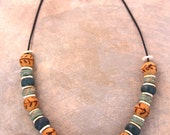 Organic Green Tribal Necklace with Clay, Wood, and Ostrich Shell Beads on Leather Boho Ethnic Tribal Jewelry