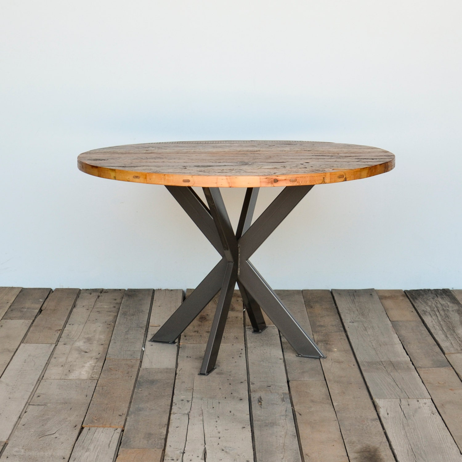 Round dining table in reclaimed wood and steel legs in your for Table a manger ronde extensible