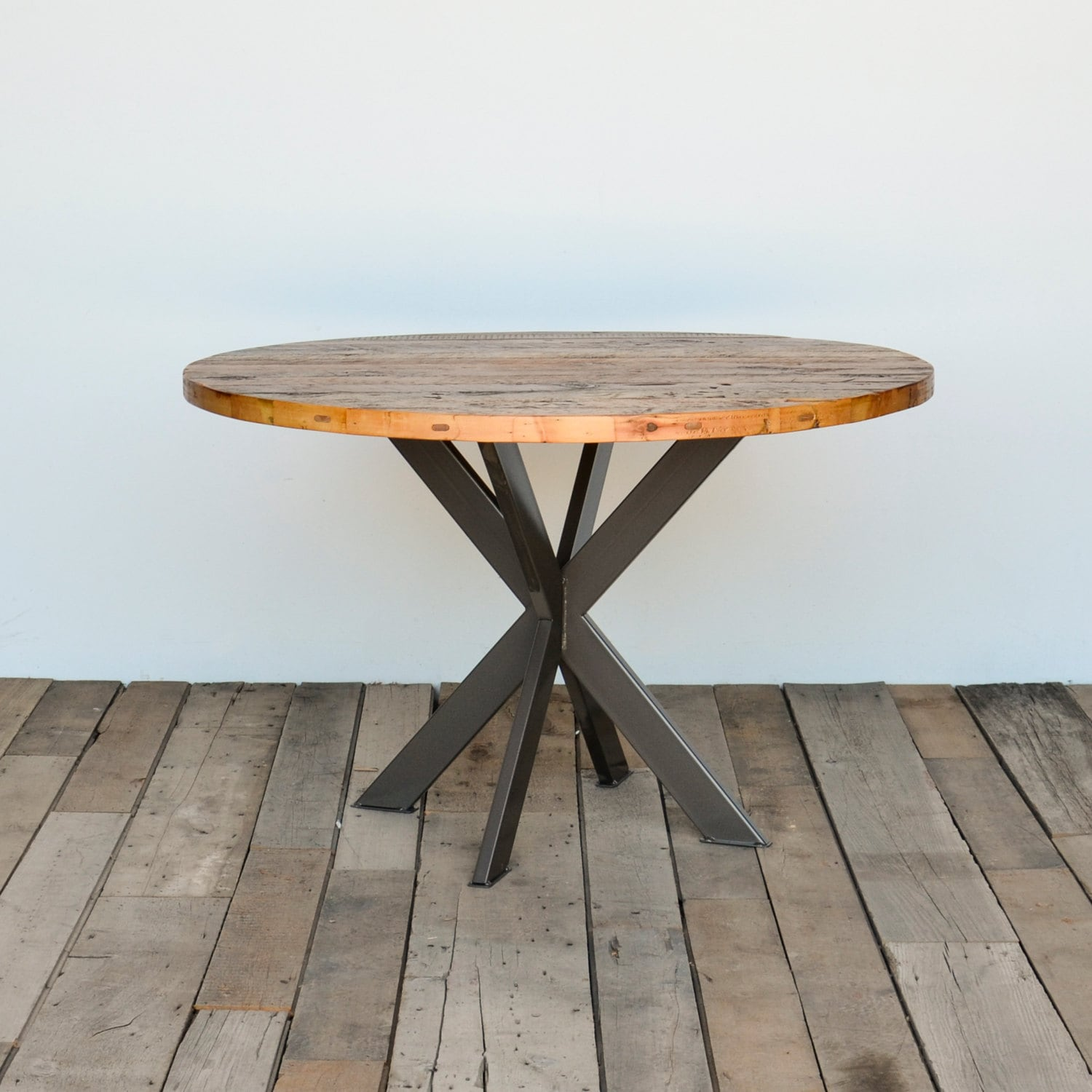 Round dining table in reclaimed wood and steel legs in your for Table a manger carre extensible