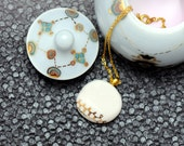 Porcelain necklace, white with gold pattern