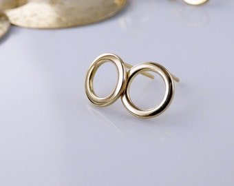 Small circle stud earrings. Gold tone brass studs. Dainty delicate minimalist jewelry.