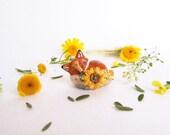 Fox figurine. Floral fox sculpture with sunflower
