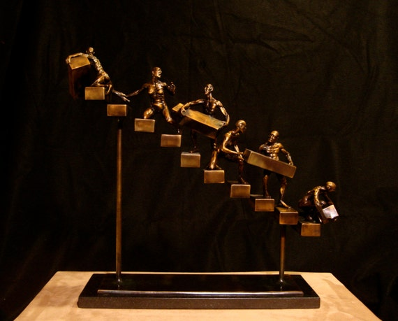 """Progression, bronze sculpture, edition 50, 18""""x25""""x6""""  Sculpture both hangs on the wall and sits on the base with 'legs' (as shown)"""