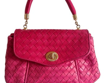Vintage Bottega Veneta intrecciato woven leather purse in hot pink with unique opening closure motif. One of a kind.