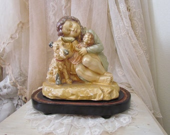 French Chalkware Sleeping Girl With Dog and Doll Statue Pearlized Luster Paint